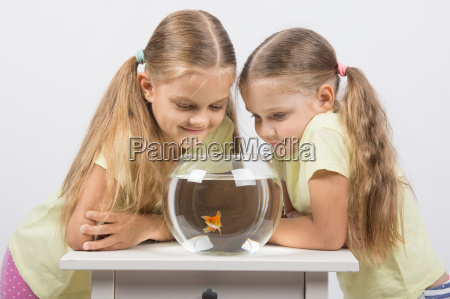 two girls looking down at a