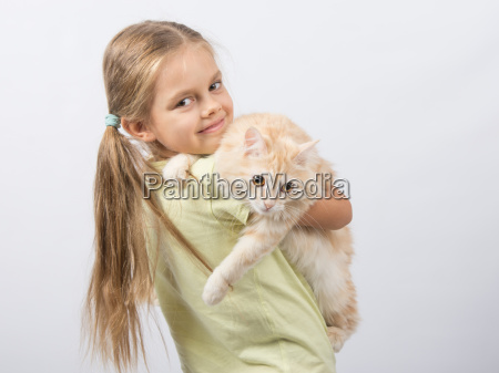 six year old girl holding a