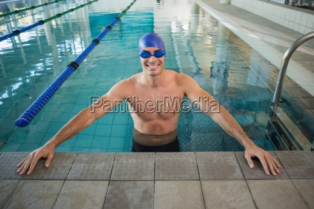 fit swimmer in the pool at