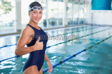 fit swimmer gesturing thumbs up by