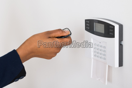 persons hand operating entrance security system