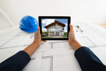 persons hand holding digital tablet