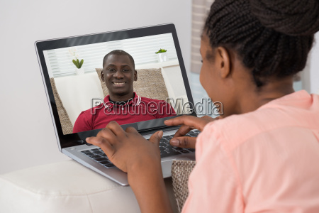 woman video chatting with man on