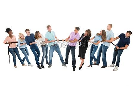 creative business teams playing tug of