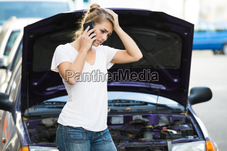 woman using mobile phone while looking
