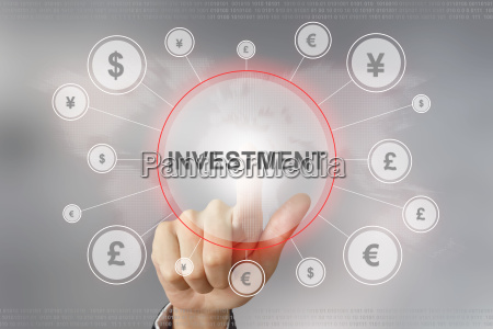 business hand pushing investment button