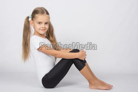 gymnast six years sitting hugging her