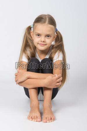 girl, gymnast, sitting, on, the, floor - 15432065
