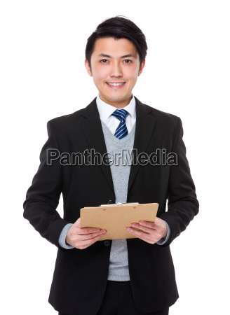 asian businessman hold with clipboard
