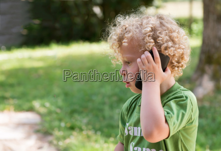 little blond boy playing with a