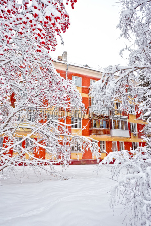 apartment condominiums in winter with covered