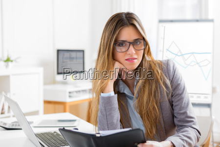 young attractive woman working at the