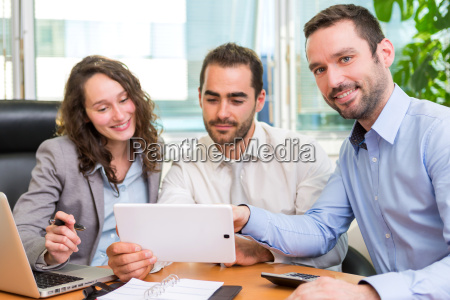 group of business associates working together