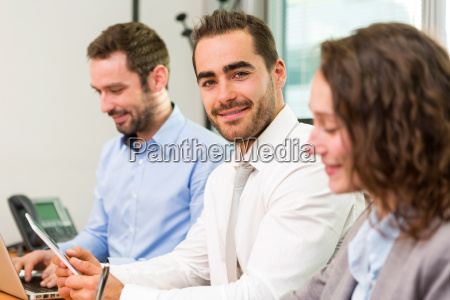 young attractive businessman working at the