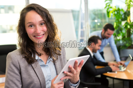 young attractive businesswoman working at the