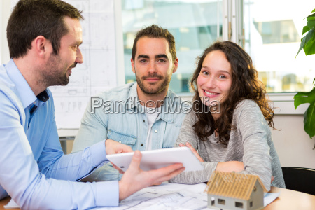 young attractive people meeting real estate