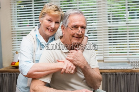 senior couple smiling at the camera