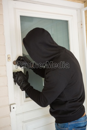 burglar breaking open the door
