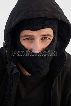portrait of burglar wearing a balaclava