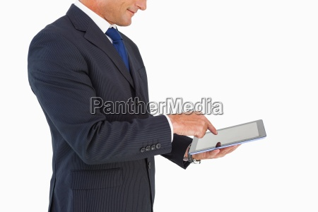 businessman in suit using digital tablet