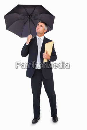 cheerful businessman holding a file under