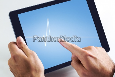 composite image of man using tablet