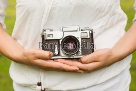 mid section of woman holding retro