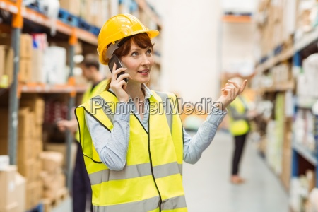 warehouse manager talking on the phone