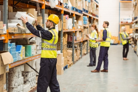 warehouse worker taking package in the