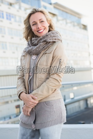 happy blonde in warm clothes posing