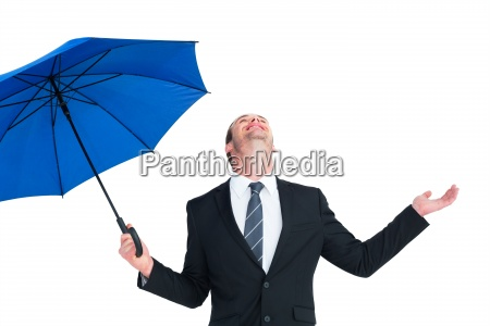 happy businessman holding blue umbrella and