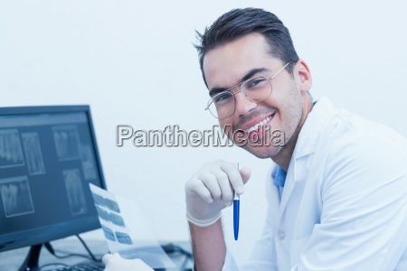 male dentist with x ray on