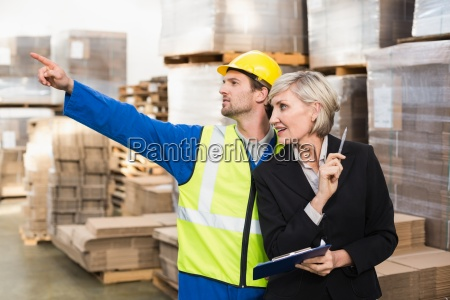 warehouse worker and his manager working