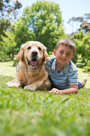 little boy with his dog in