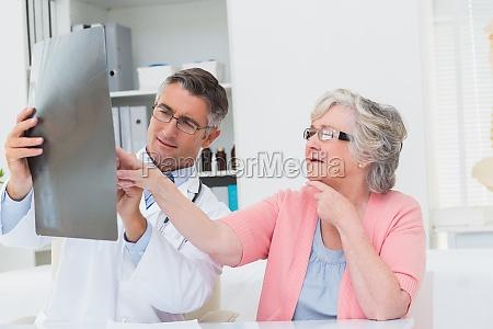 doctor explaining x ray to senior