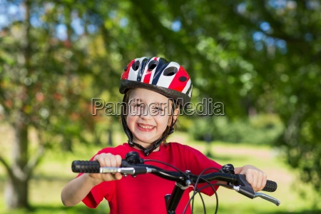 happy little boy on his bike