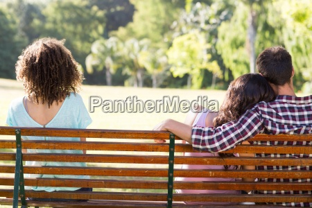 lonely woman sitting with couple in