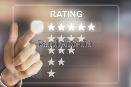 business hand pushing rating on virtual