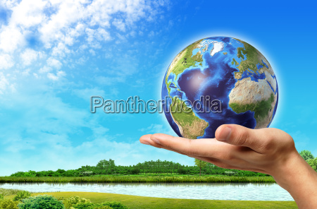 man hand with earth globe on