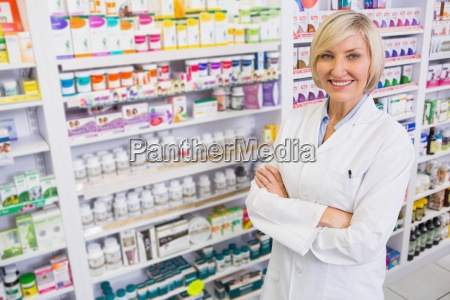 blonde pharmacist with arms crossed smiling