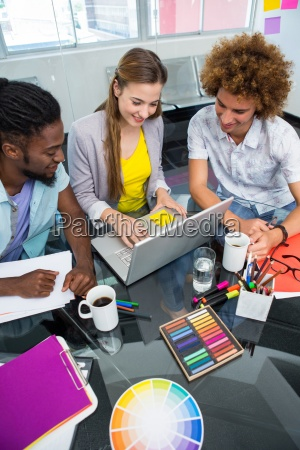 creative business people using laptop at