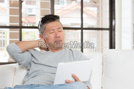 mature asian man neck pain while
