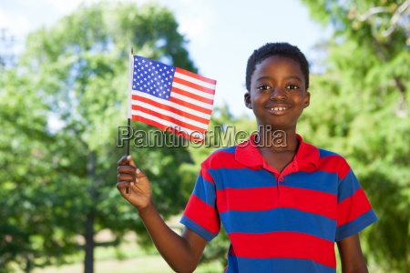 little boy waving american flag