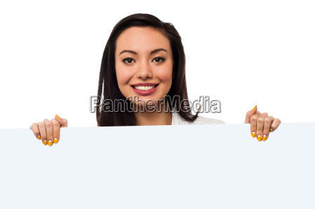 smiling lady holding billboard for ad