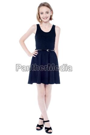 elegant charming girl in sleeveless dress
