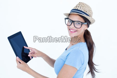 smiling woman using her tablet looking