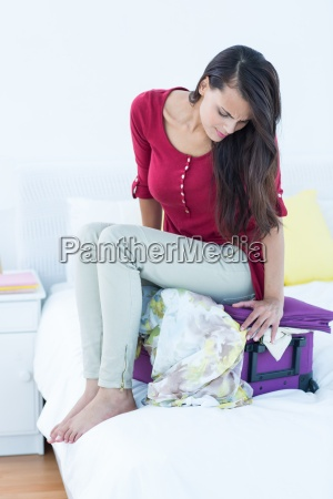 woman sitting down on top of