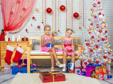 happy sister holding gifts in their