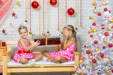 girl gives another girl a gift