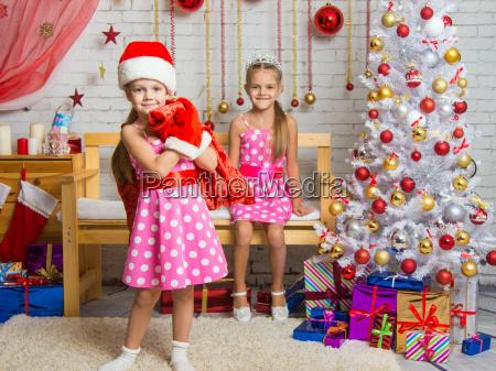 girl dressed as santa claus brought